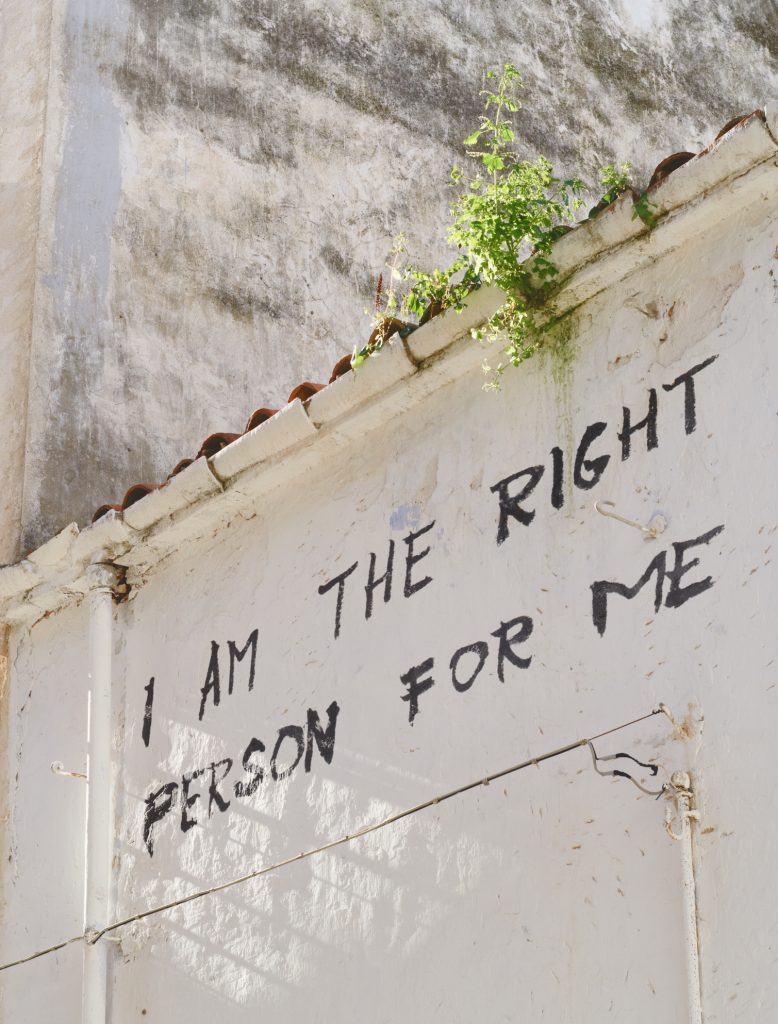 "Graffiti that says ""I am the right person for me""."